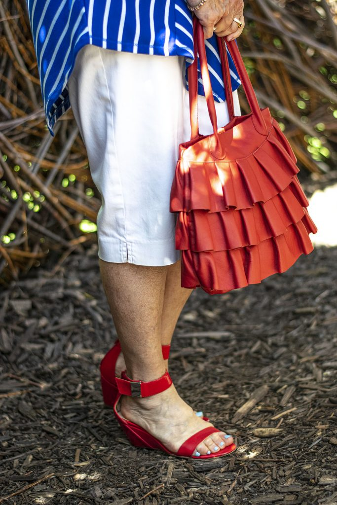 Red pops in purse and shoes