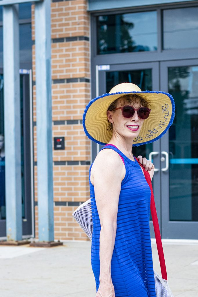 Hat and dress as after workout cover up