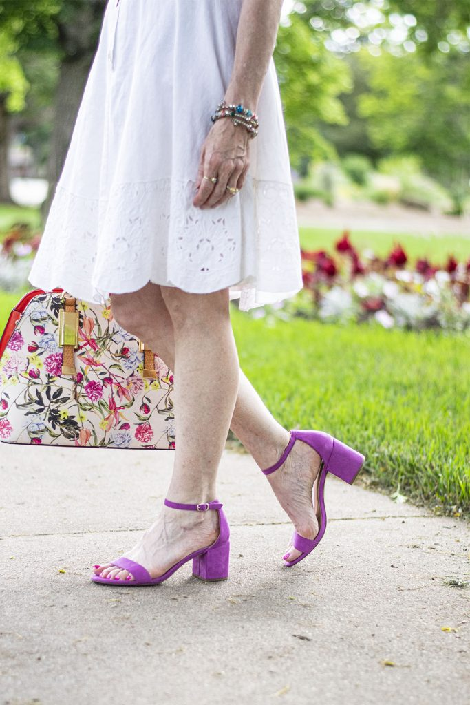Wearing the little white dress with colorful shoes