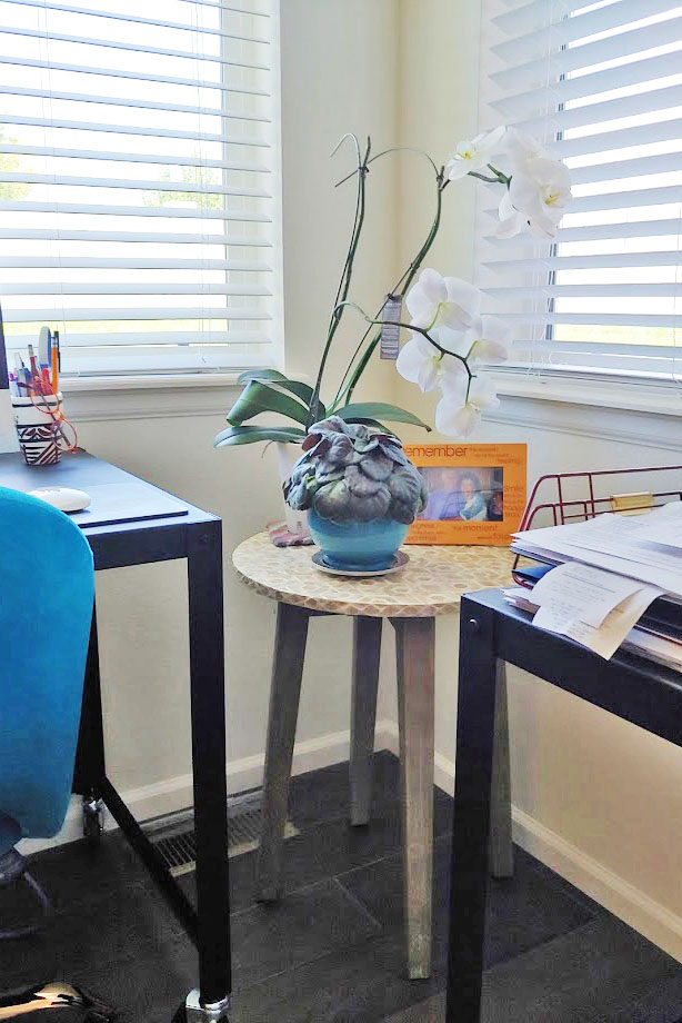 Creating a home office space with a plant stand