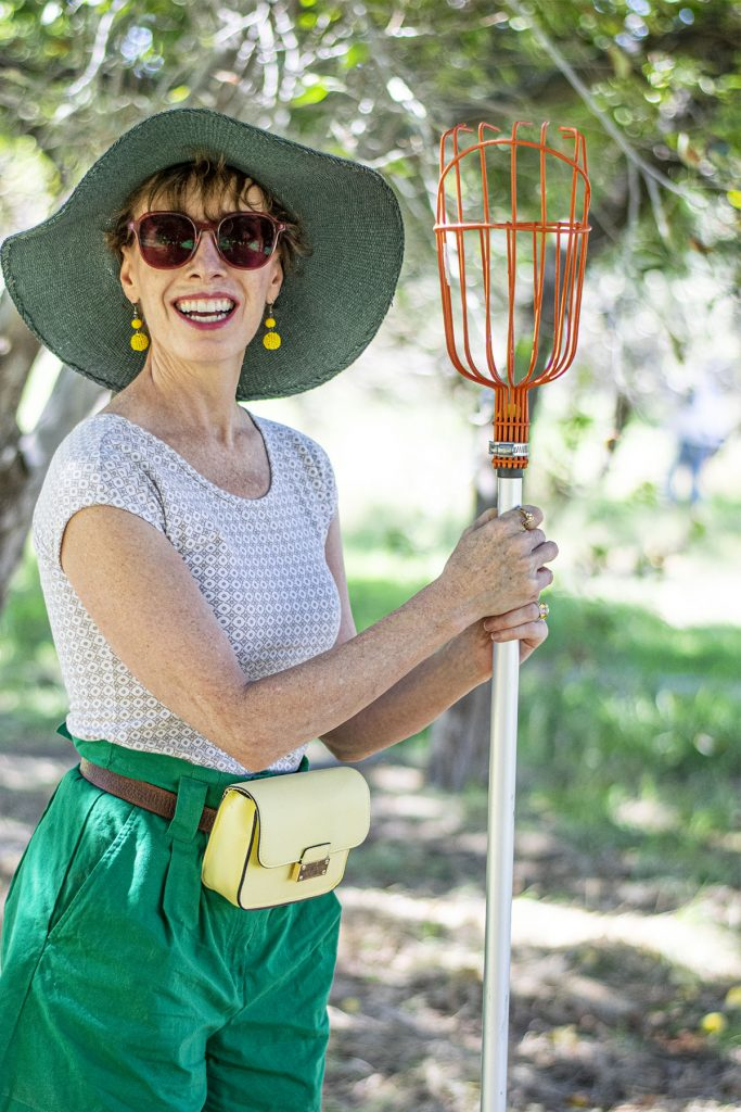 Midlife woman in cute apple picking outfit