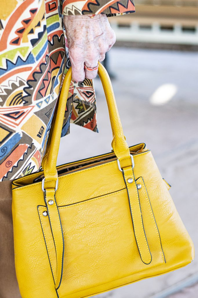 Yellow purse as a punch of color