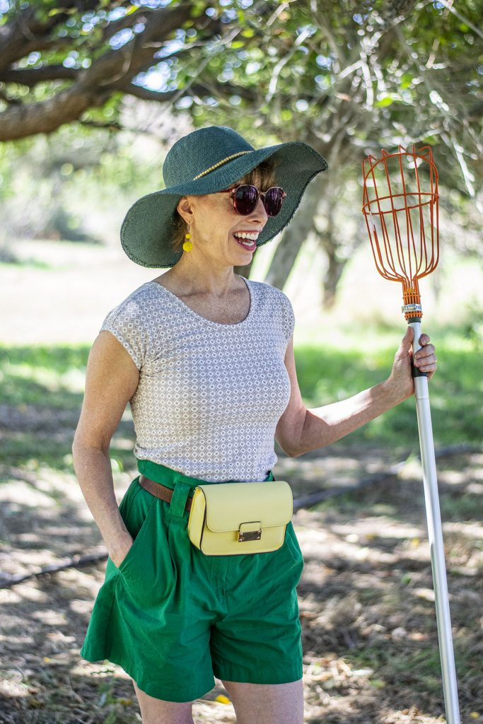 In an orchard with a cute apple picking outfit
