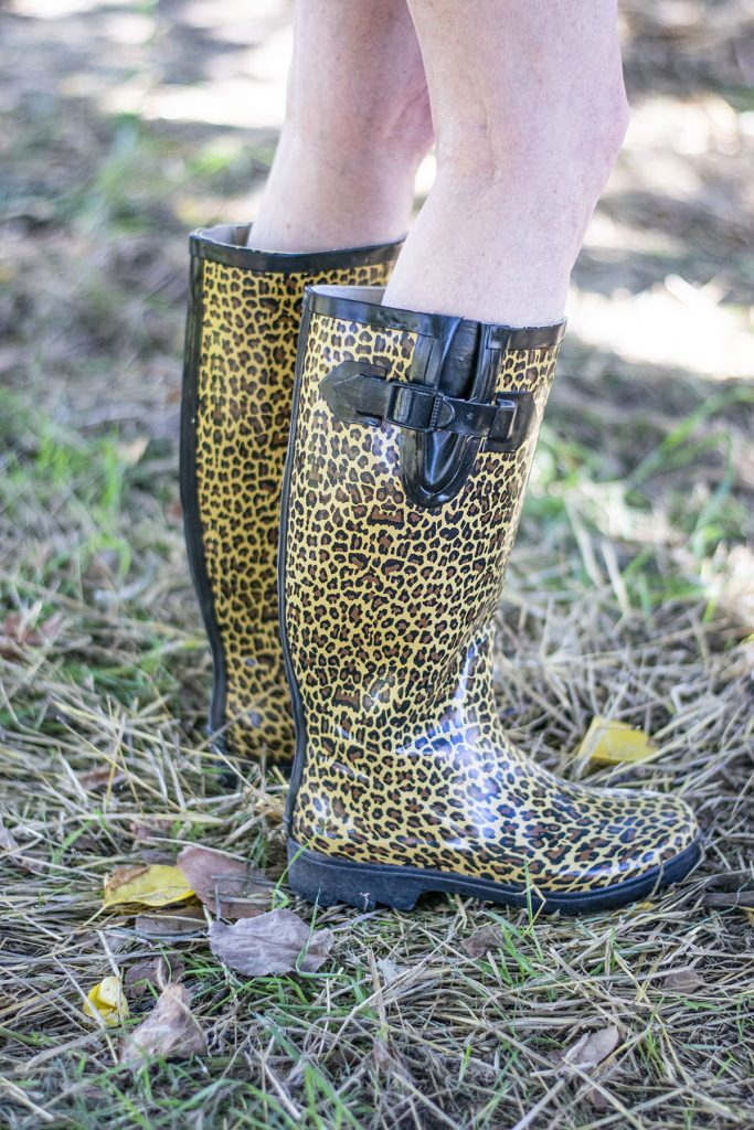 Rainboots as part of a cute apple picking outfit