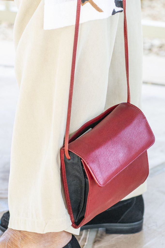 How to style loafers with a different colored purse
