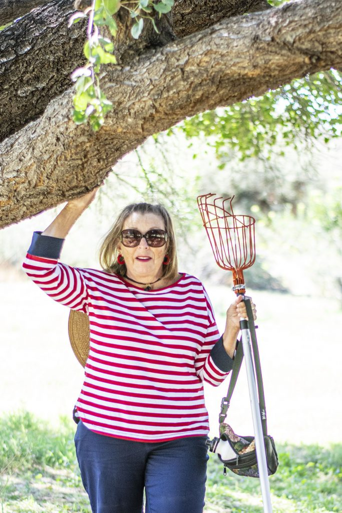 Woman in red and white striped top