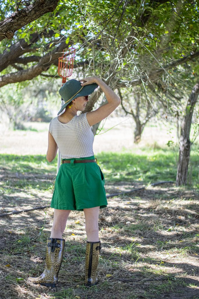Woman over 50 in cute apple picking outfit