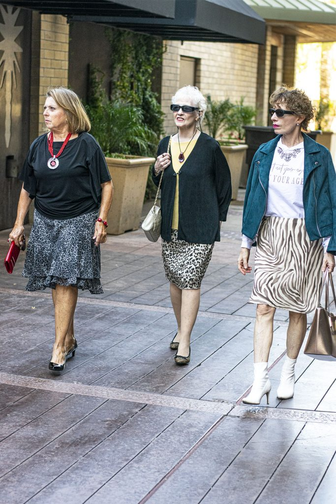 3 women styling animal print skirts