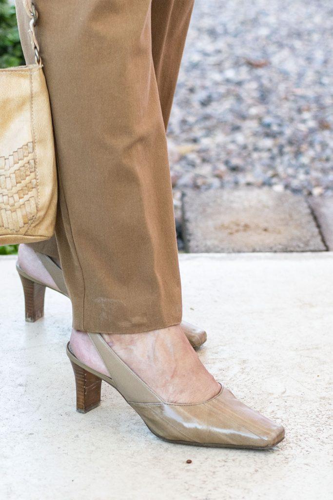 Brown pants and tan heels