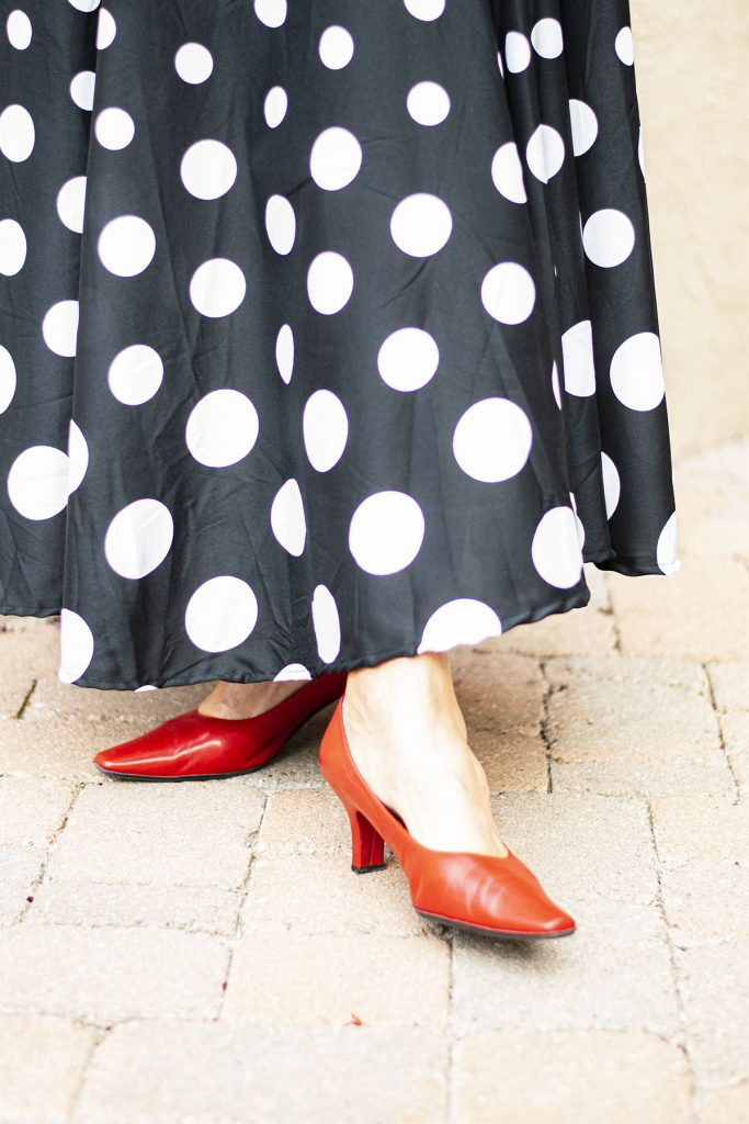 Red heels with a black and white outfit