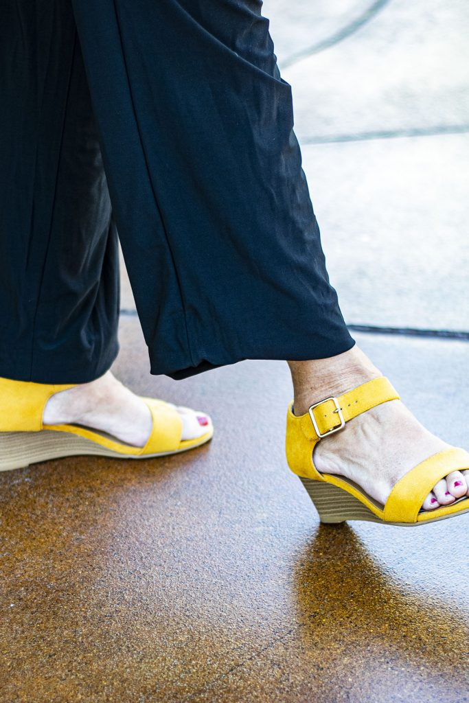 Yellow sandals as a punch of color
