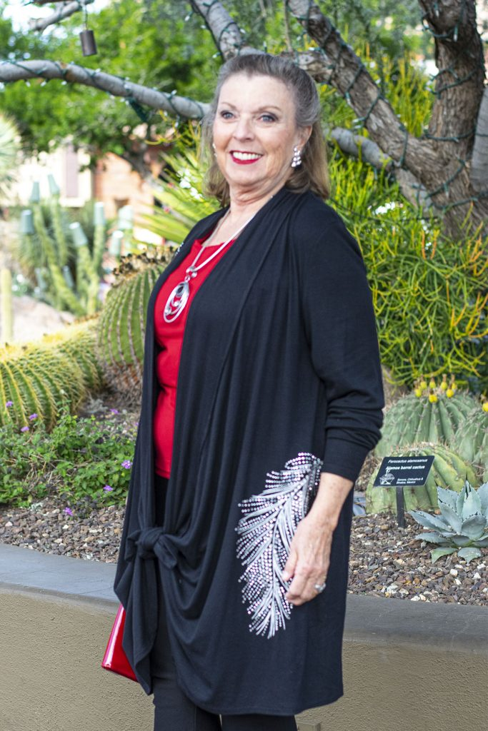 Woman over 60 with red and black