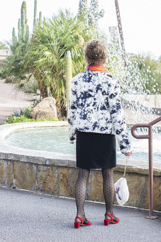 Woman in tights and sandals for the holidays