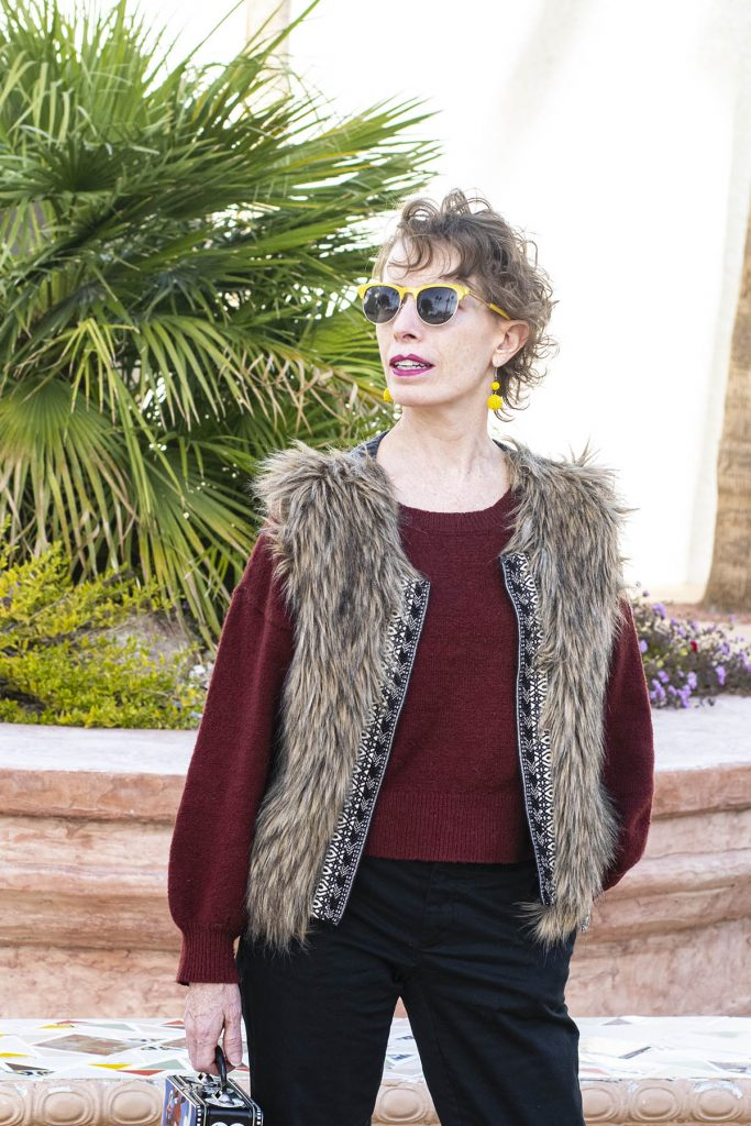 Wearing a faux fur vest for winter