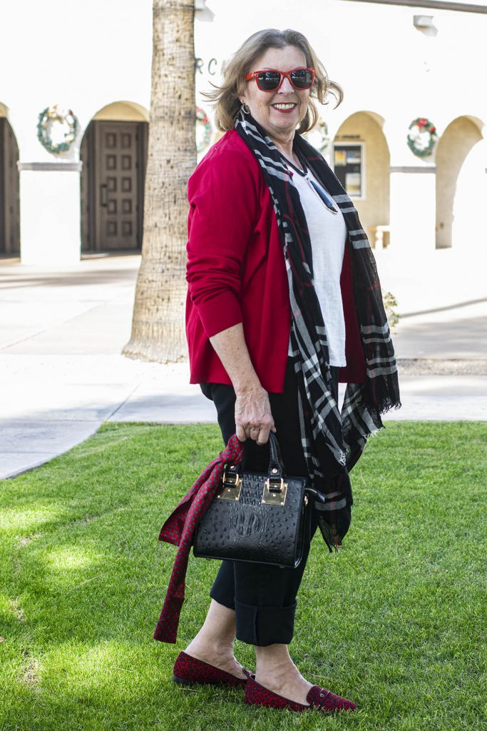 Woman over 60 in red cardigan outfit