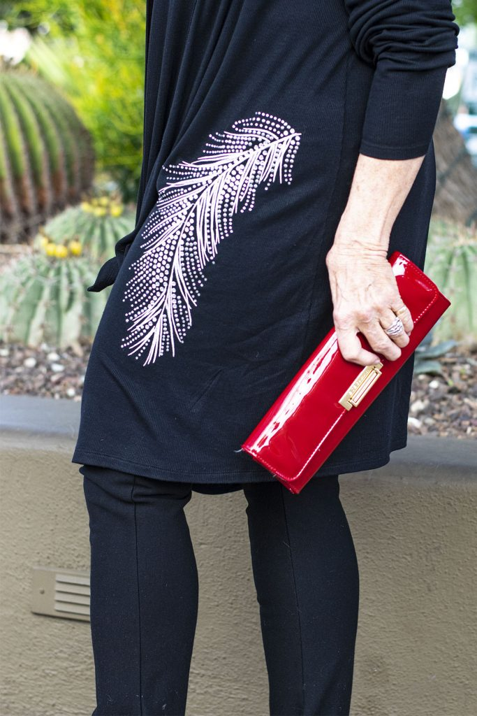 A pop of red with the purse