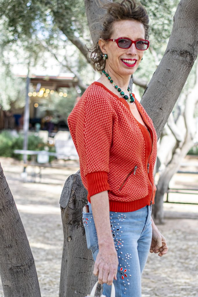 Woman over 50 and a spring outfit with jeans