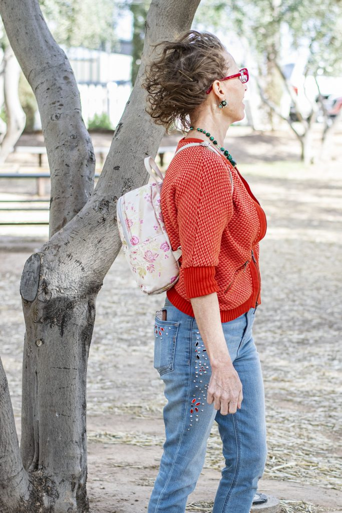 Orange and pink cardigan as a spring outfit with jeans