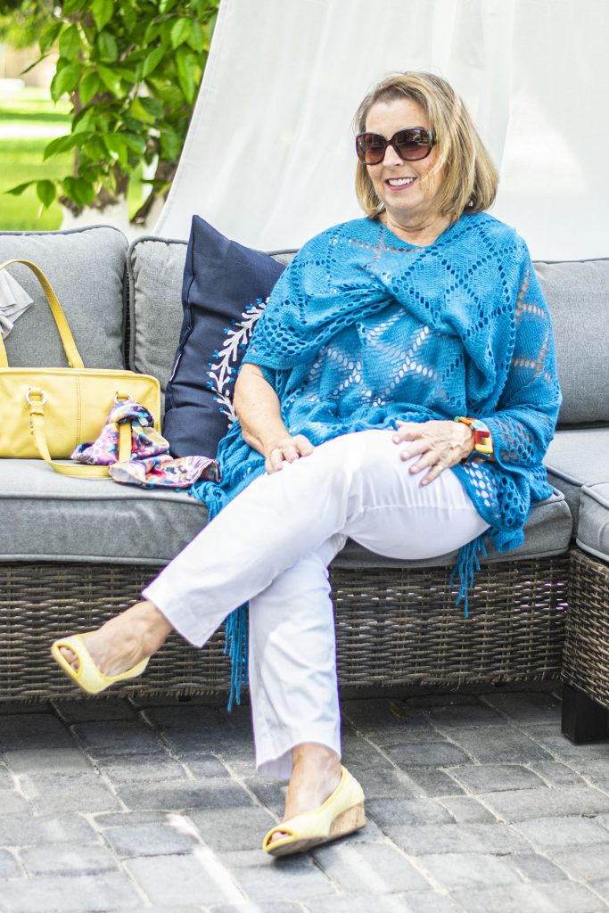 White jeans and crochet poncho