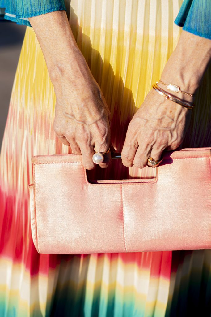 Pink purse and pearl ring
