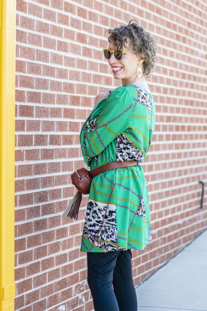 Woman over 50 wearing a belt bag