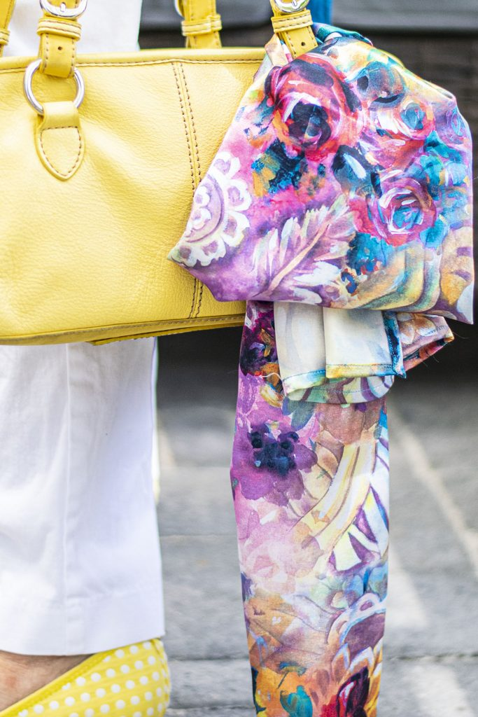 Yellow purse with a scarf