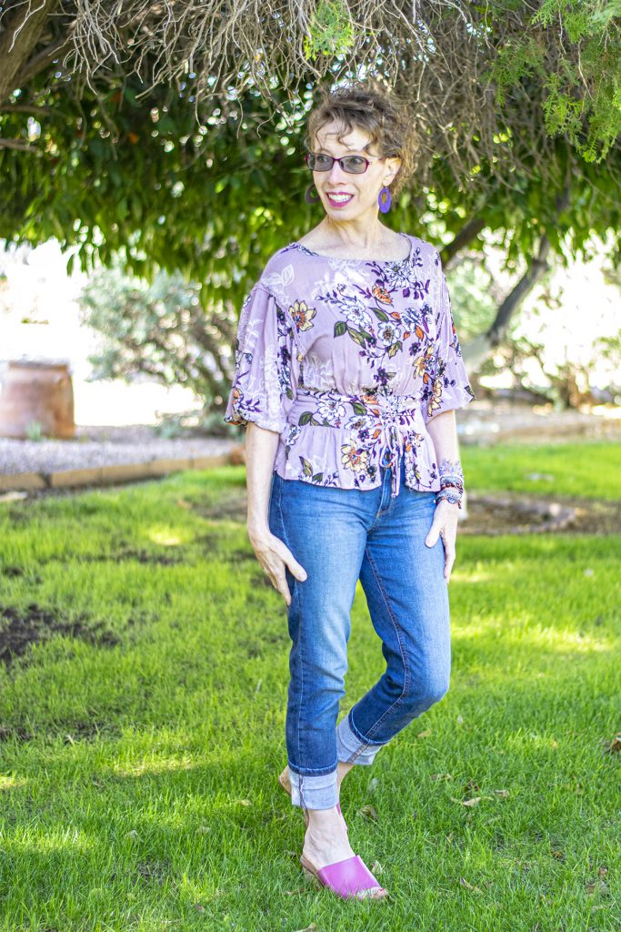 Lilac floral top with wearing jeans in the summer