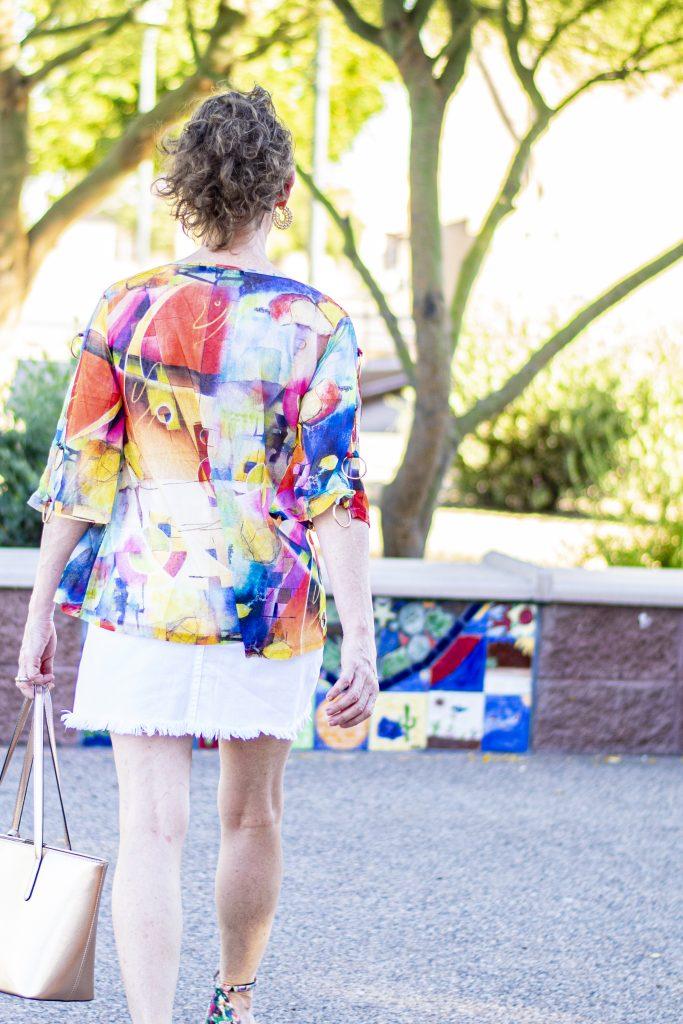 Sheer top and denim skirt