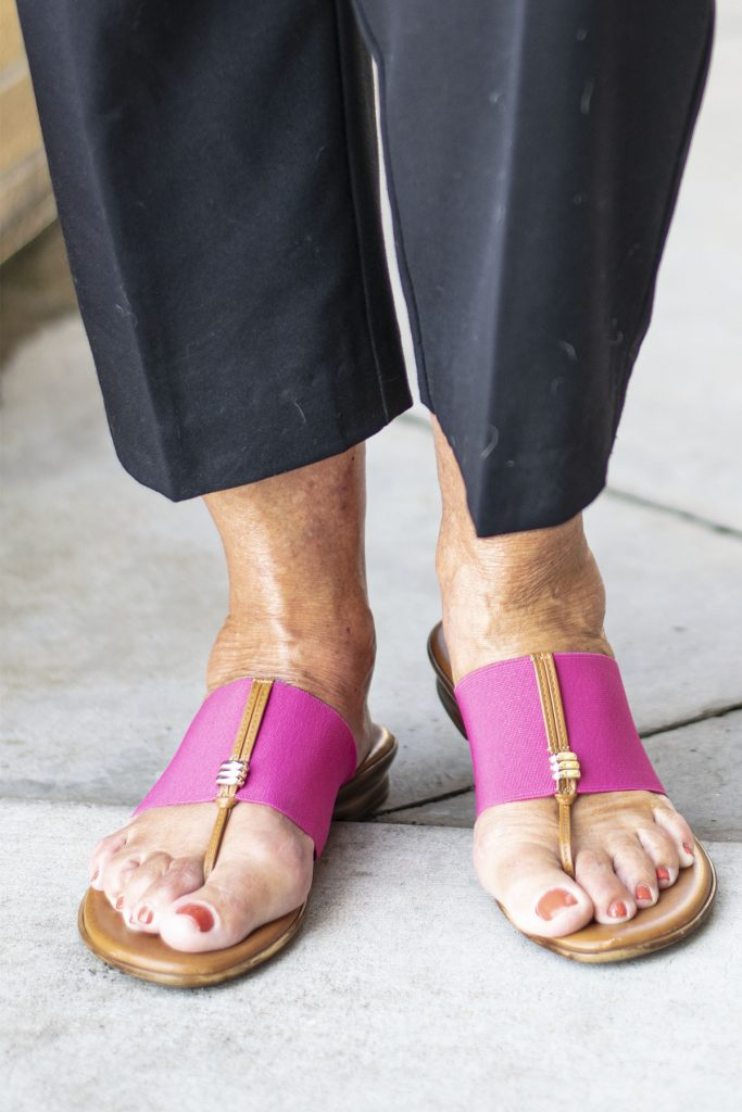 Pink sandals with black pants