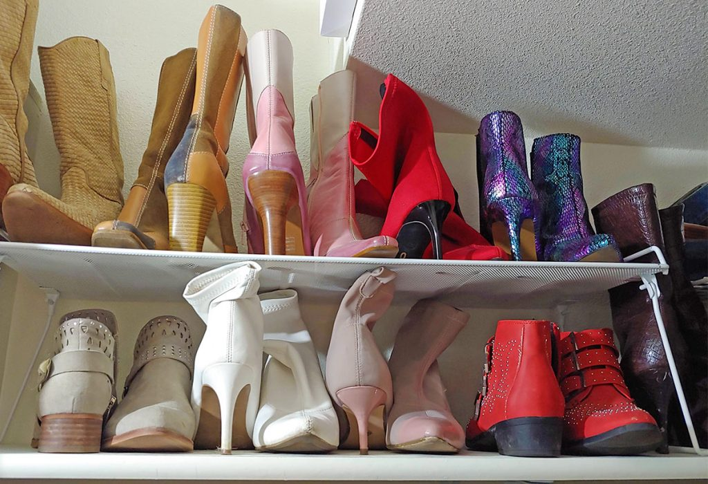 Light colored ankle boots as part of a closet tour