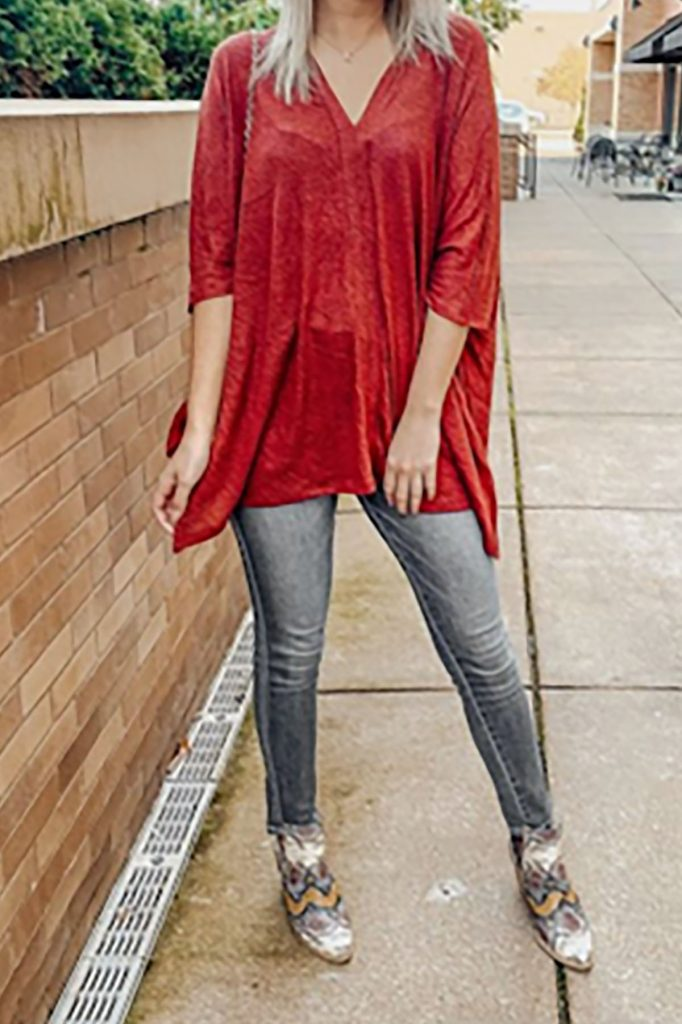 How to not look frumpy in an oversized red top