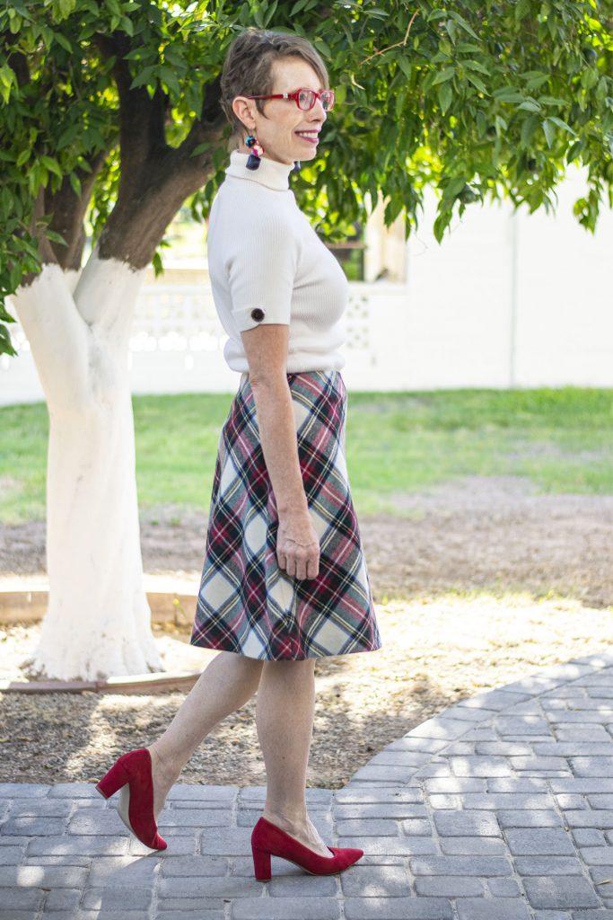 Styling a skirt over a dress for women