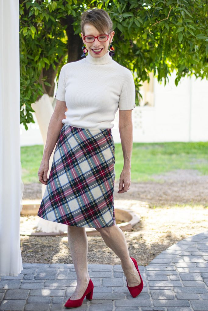 A line layering skirt over a dress
