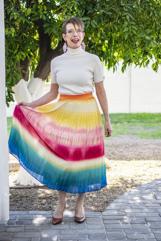Pleated skirt layering over a dress
