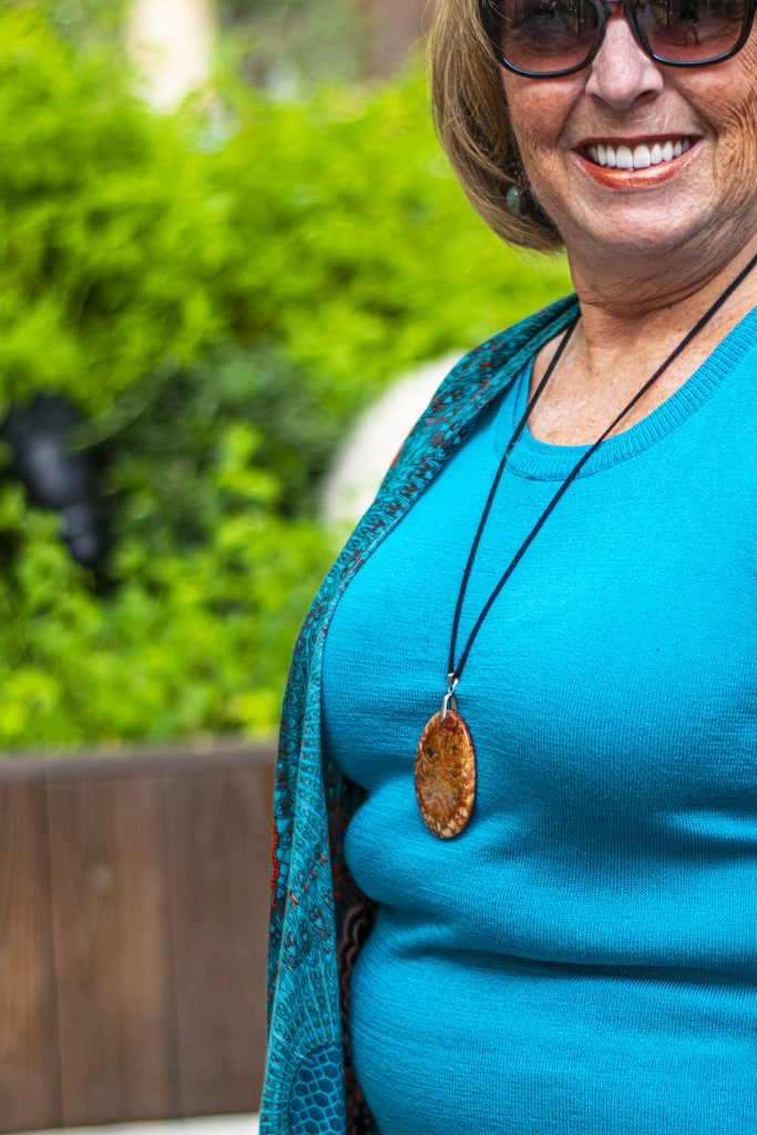 Turquoise and rust as part of fall transition outfits