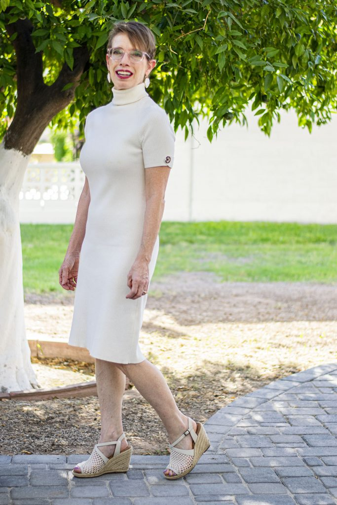 White dress used for layering a skirt over a dress