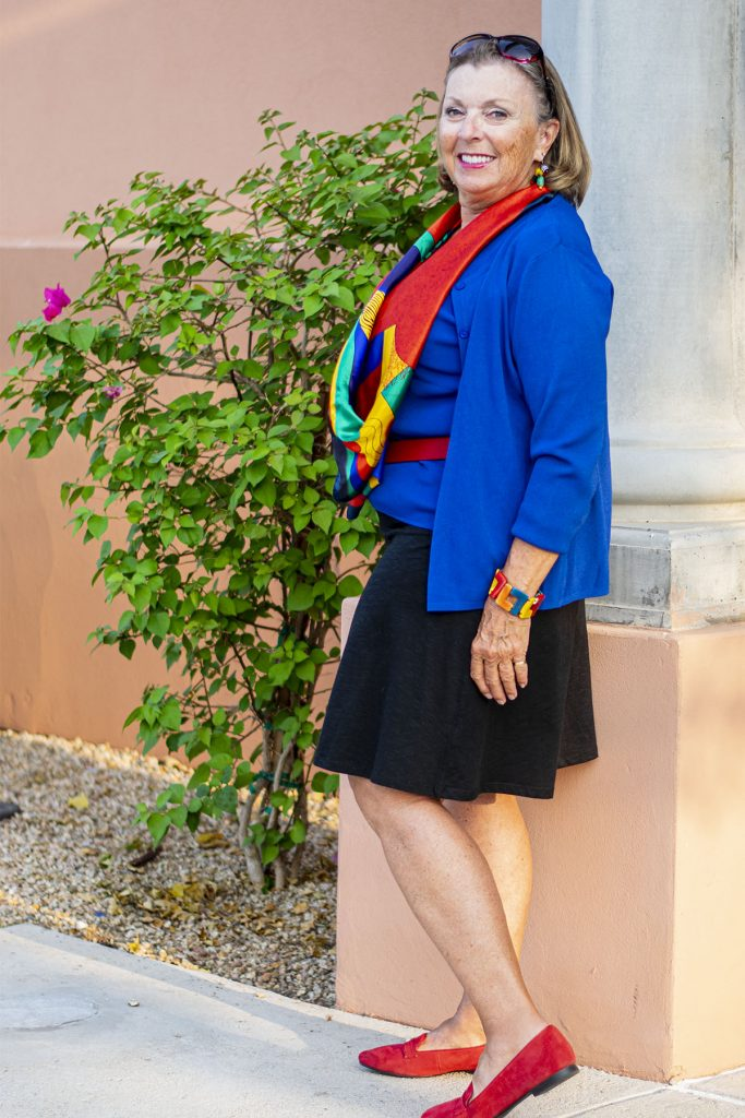 Scarf ties in with flattering colors