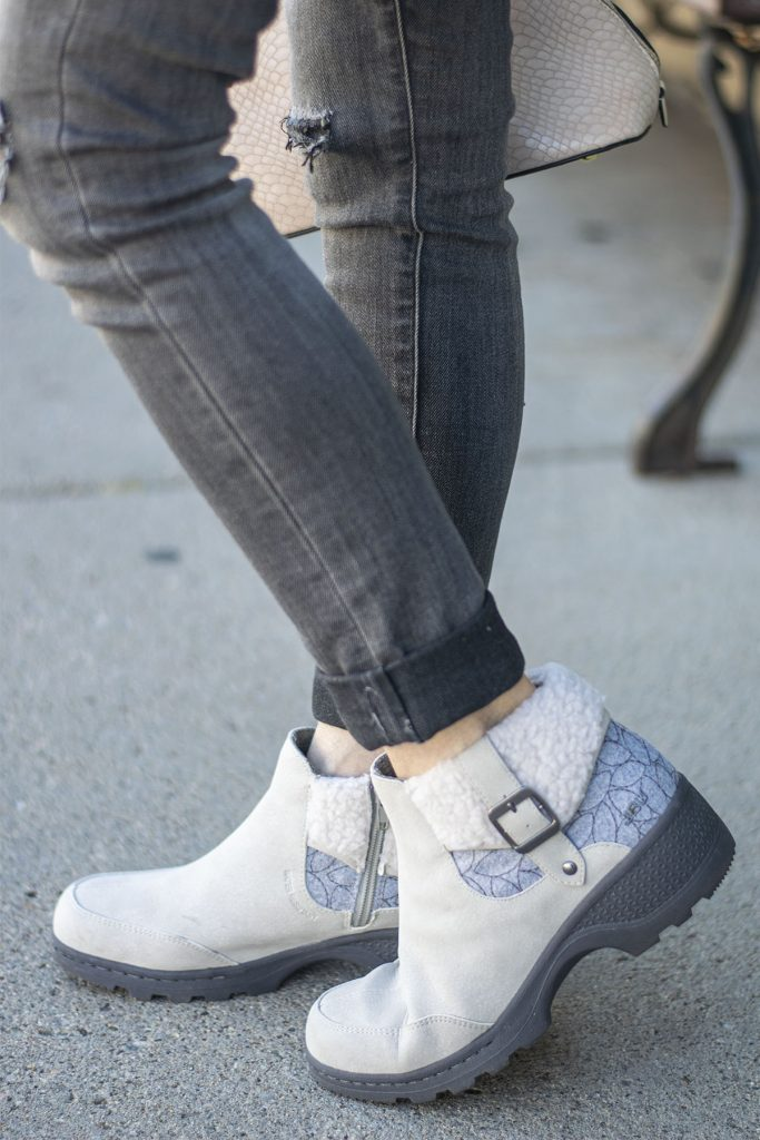 Warm stylish boots with grey jeans