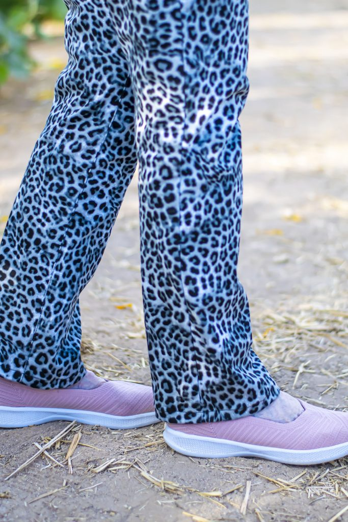 Pink shoes with leopard jeans