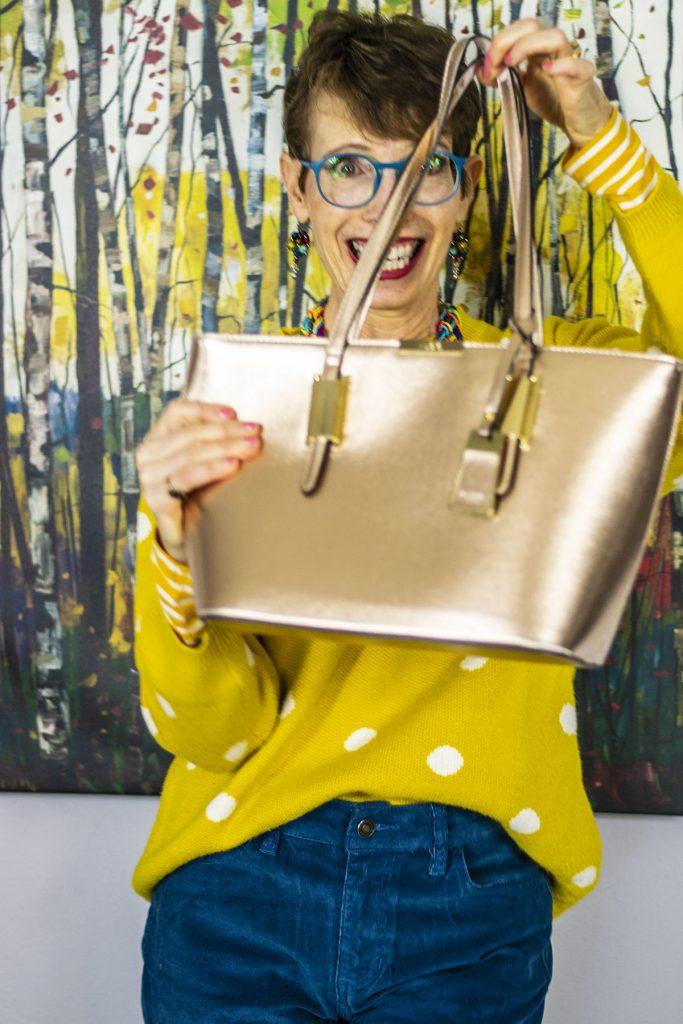 Neutral handbag color that shines