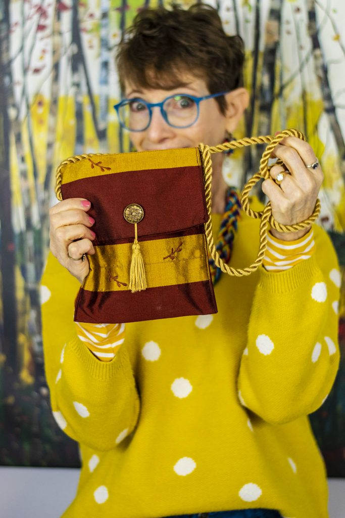 Gold and burgundy hands free bags