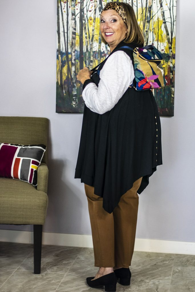 Adding color to an outfit with hands free bags