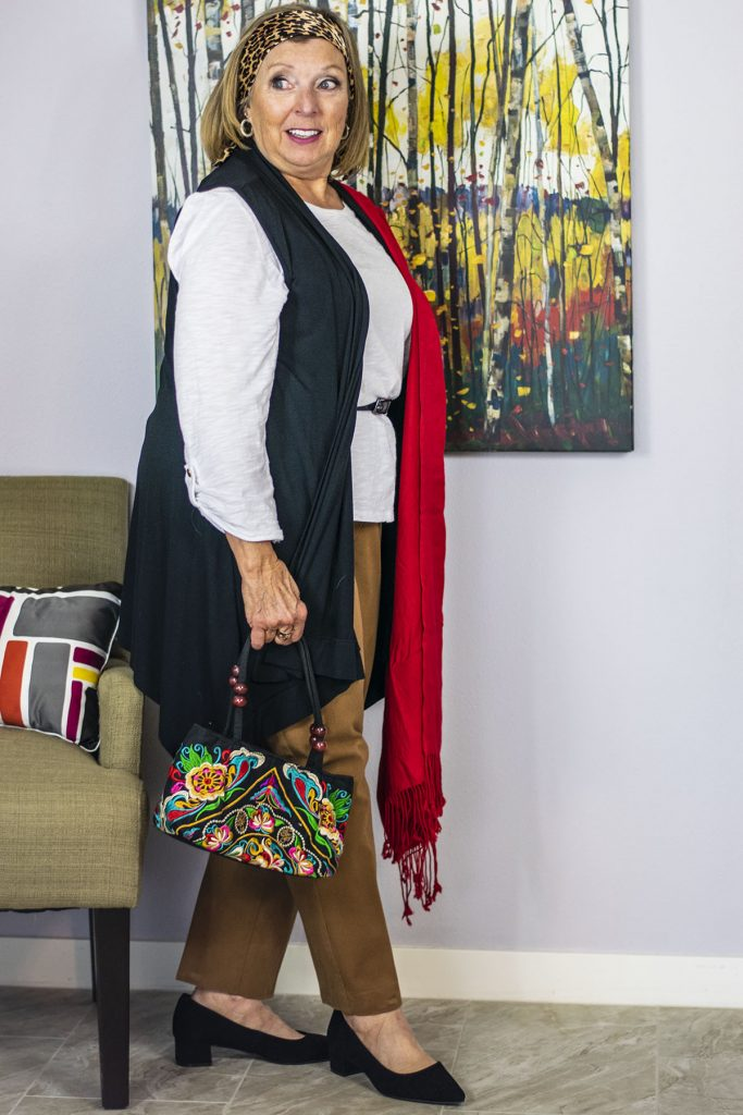 Adding color with handbag color and scarf