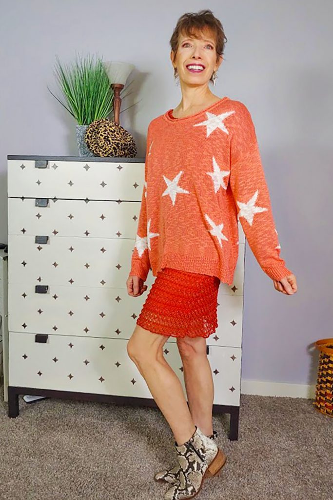How to style an oversized sweater over a dress