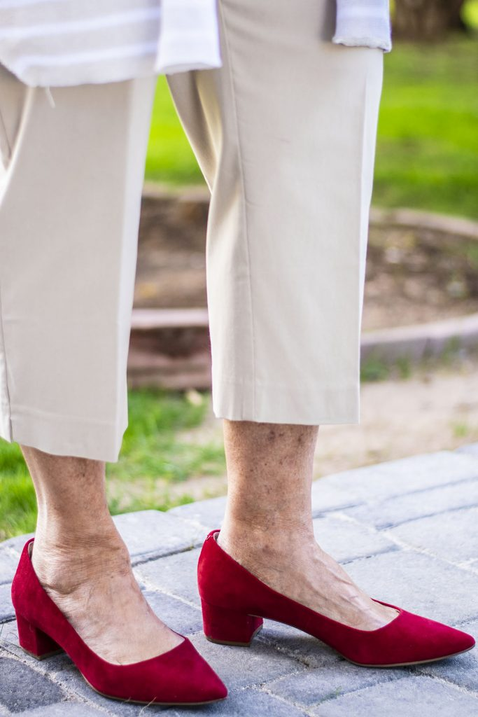 Red heels with cropped pants