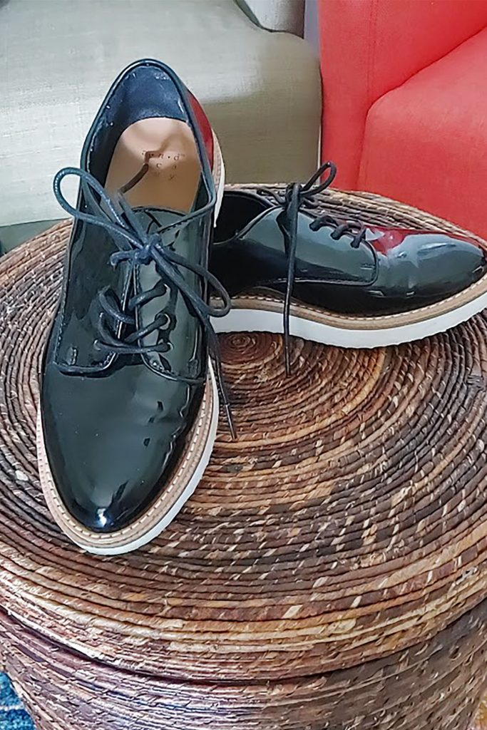 Black patent leather brogues
