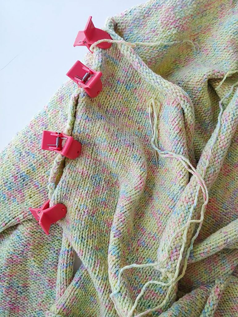 Pin the pieces together for a handknit sweater