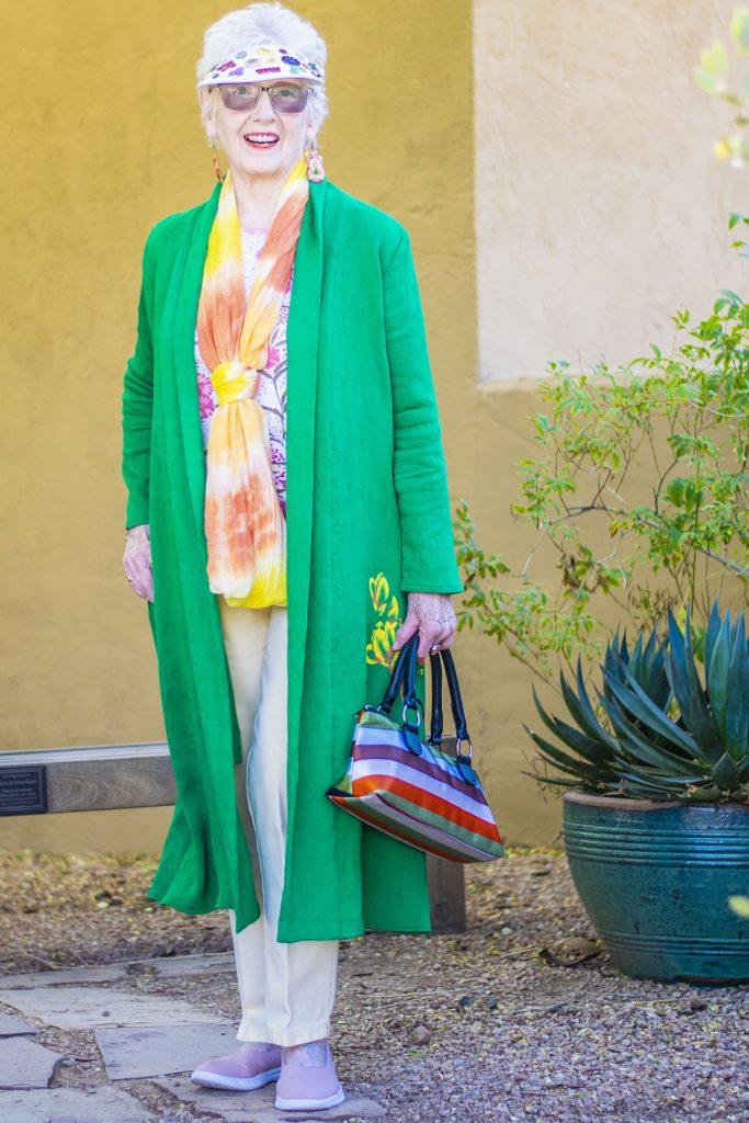 Woman over 80 in a green kimono outfit