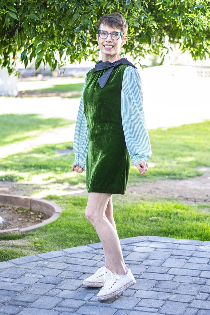Layer a bishop sleeve blouse under a sleeveless dress