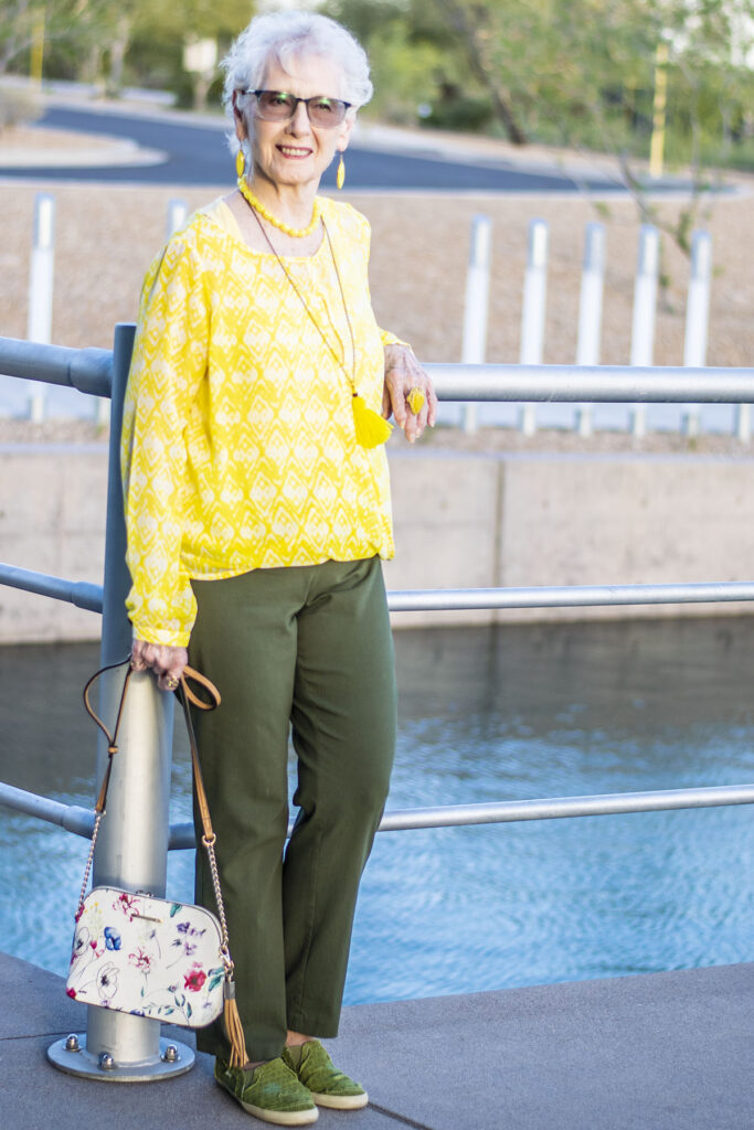 Woman over 80 in an olive green outfit